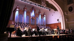Concert of classical music performed by a symphony orchestra, and choir. - stock footage
