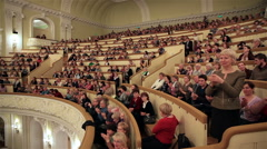 Enthusiastic audience applauding participants of concert in Moscow Conservatory. - stock footage