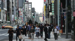 Time Lapse of Pedestrians in the Busy Ginza Shopping District  -  Tokyo Japan Stock Footage