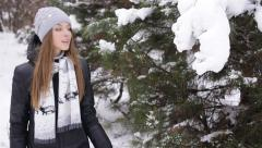Beauriful woman walking in showy winter forest - stock footage