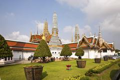 Famous prangs in the grand palace in bangkok in the temple area of the emeral Stock Photos