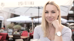 Portrait of beautiful blond woman in cafe. FULL HD.close up - stock footage