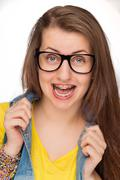 Crazy girl with braces wearing geek glasses - stock photo