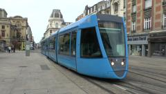 An electric tram leaving a tram stop in Reims, Champagne-Ardenne, France. Stock Footage