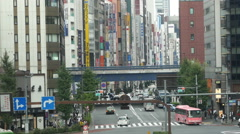 Time Lapse Traffic / Pedestrians - Busy Ginza Shopping District  -  Tokyo Japan Stock Footage
