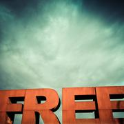 Capital letters FREE with cloudy sky Stock Photos