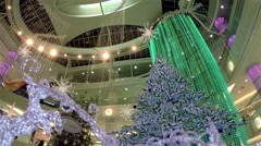 one side of shopping mall with christmas light was decorated full of building - stock footage