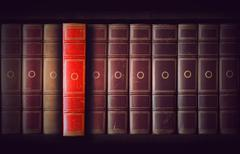 vintage books in bookcase - stock photo