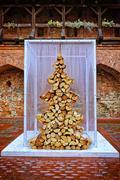Christmas tree made of fire wood Stock Photos