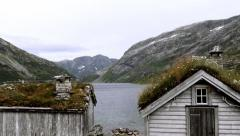 Cabins on the shore of fjord - stock footage