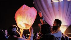 Family release Sky Lanterns Stock Footage