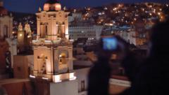 Tourist enjoy nightscape of colonial town - stock footage