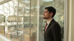 Businessman is walking around a modern open plan office building. Stock Footage