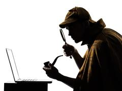 Sherlock holmes laptop computer silhouette Stock Photos