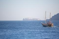 Little pleasure boat on the aegean sea - stock photo