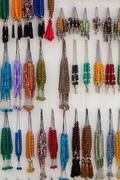 Colorful fake necklaces in a local shop Stock Photos