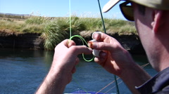 Argentina Fly Fishing - Angler untangles Knot Chubut 20 - stock footage