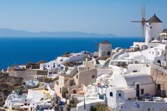 The Windmill in Oia and the Aegean Sea in Greece - stock photo