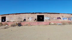Abandoned Dilapidated Factory Warehouse In Desert- Drive By Shot Stock Footage