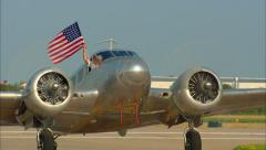 Beechcraft Model 18 Taxi with US Flag Stock Footage