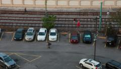 Timelapse of Cars Parking and People Walking Along Railroad Track Stock Footage