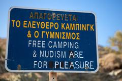 Sign: nudism is for pleasure Stock Photos