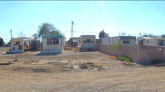 Driving By Mobile Homes In Small Desert Town- Niland CA Stock Footage