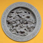 Ornamented window with dragon Stock Photos