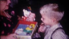 1427 - children play with all the Christmas toys - vintage film home movie Stock Footage
