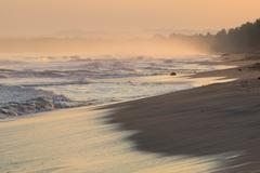 Sunrise on deserted beaches and coastline Stock Photos