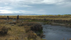 Argentina Fly Fishing - Guide and Angler scout river Stock Footage