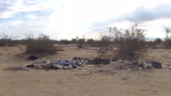 Stock Video Footage of Piles Of Trash Left By Desert Squatters Pan- Niland CA