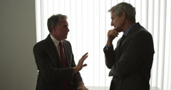 Senior businessmen having a discussion Stock Footage