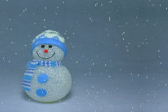 Snow Falling on artificial Snowman Stock Footage
