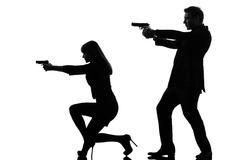Couple woman man detective secret agent criminal  silhouette Kuvituskuvat