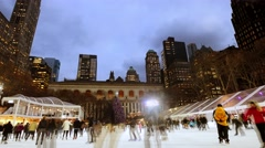 Ice skating rink at bryant park in new york city. people enjoying holidays Stock Footage