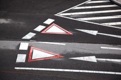 Yield sign marked at the street in vienna, austria Stock Photos
