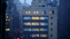rain pouring down on window glass. bad weather background. snow fall in the city - stock footage