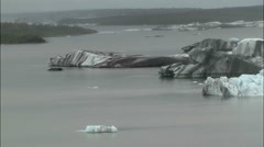 Aerial floating icebergs moraine dirt glacier textured surface - stock footage