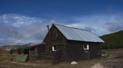 Argentina Scenic - log house with rainbow Stock Footage