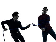 Two  men twin brother friends conflict  silhouette Stock Photos