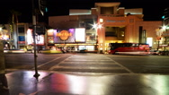 Stock Video Footage of Time Lapse of Busy Crosswalk on Hollywood Blvd. at Night -Tilt Down-