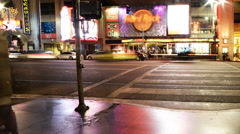 Time Lapse of Busy Crosswalk on Hollywood Blvd. at Night -Pan Right- - stock footage