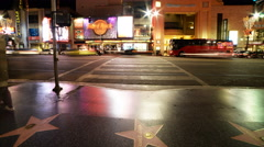 4K Time Lapse of Busy Crosswalk on Hollywood Blvd. at Night -Tilt Up- Stock Footage