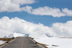 Straight road to Himalayas range, Tibet Stock Photos