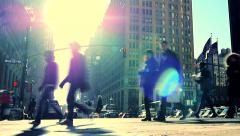 Walking people crossing street in new york city. sun flare urban lifestyle Stock Footage
