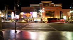 4K Time Lapse of Busy Crosswalk on Hollywood Blvd. at Night -Tilt Down- - stock footage