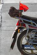 Communist flag at the backside of a bike - stock photo