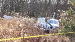 Light plane crash near highway Stock Footage