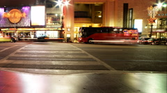 4K Time Lapse of Busy Crosswalk on Hollywood Blvd. at Night -Pan Left- Stock Footage
